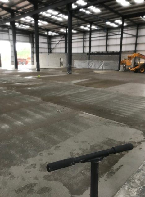 Dry shake applied to surface of the concrete slab