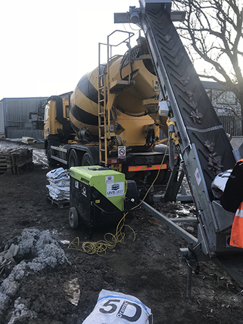 1. Steel fibres are integrated into the concrete truck mixer via the concrete flooring contractors conveyor system. Once the steel fibres have been fully integrated a superplasticiser is added to the mix to increase the workability to slump class S4.