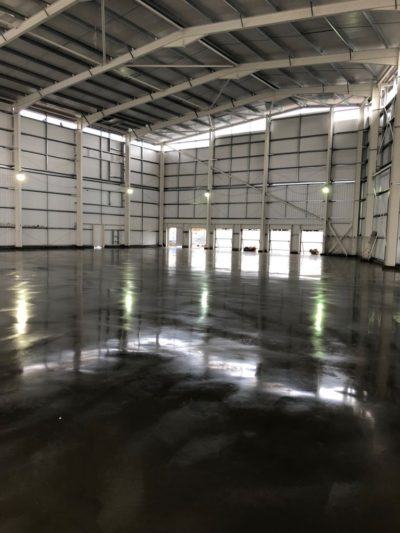 Jointless steel fibre reinforced concrete ground bearing floor slab constructed in Mitcham, near Croydon in Surrey by Level Best Concrete Flooring from Yorkshire.