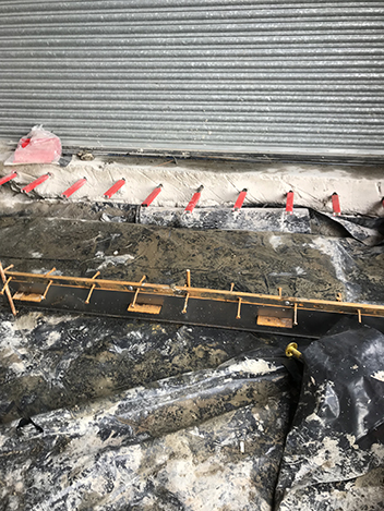 4. If steel permanent construction joints are required, they are installed prior to the concrete being cast. Existing doorway floor slabs are dowelled at the designed centres to create the load transfer between the concrete floors.