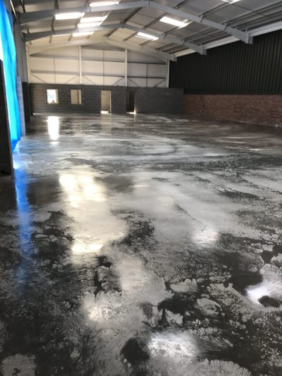 200mm deep cast insitu warehouse concrete floor slab constructed by industrial concrete flooring contractors Level Best Concrete Flooring.