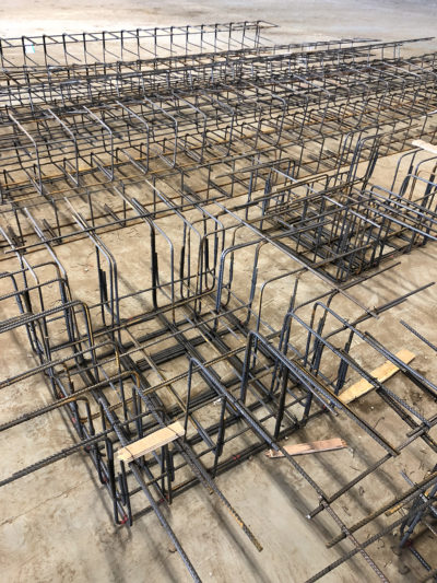Specialist reinforcement installed for suspended warehouse concrete floor slab in Burton On Trent.
