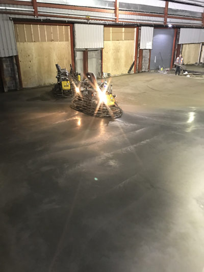 How the dry shake topping looks once it has been successfully powerfloated into the surface of the industrial concrete floor slab.