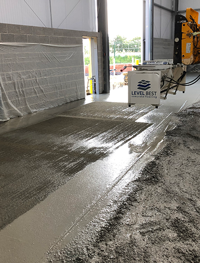 Level Best's newest innovative topping spreader, ensuring a consistent coloured finish and guaranteed fibre suppression for this D&B floor slab